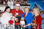 Tara Collins, Tony Moore, Anne Sullivan and Geraldine O'Sullivan getting into the spirit of Christmas at the pop up Christmas store in Moriartys furniture store on Thursday evening
