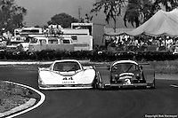 The Group 44 Jaguar XJR-5 004 elbows its way underneath the Grid Plaza S1 GA01/Ford during the 1983 12 Hours of Sebring.