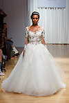 Model walks runway in a Maisie gown from the Casablanca Bridal collection at the Casablanca Bridal 20th anniversary celebration runway show, on October 8, 2017; during New York Bridal Fashion Week Spring 2018.