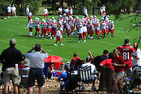 Jul 31, 2009; Flagstaff, AZ, USA; Fans look on as Arizona Cardinals players huddle during training camp on the campus of Northern Arizona University. Mandatory Credit: Mark J. Rebilas-
