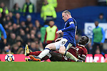 Wayne Rooney of Everton is challenged by Sadio Mane of Liverpool during the premier league match at Goodison Park Stadium, Liverpool. Picture date 7th April 2018. Picture credit should read: Robin Parker/Sportimage