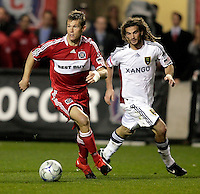 Chicago Fire forward Brian McBride (20) looks to pass while Real Salt Lake midfielder Kyle Beckerman (5) pursues.  Real Salt Lake defeated the Chicago Fire in a penalty kick shootout 0-0 (5-4 PK) in the Eastern Conference Final at Toyota Park in Bridgeview, IL on November 14, 2009.