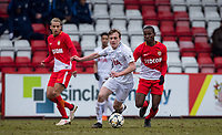 Oliver Skipp of Spurs U19 moves from Ibrahima Diallo of AS Monaco FC Youth during the UEFA Youth League round of 16 match between Tottenham Hotspur U19 and Monaco at Lamex Stadium, Stevenage, England on 21 February 2018. Photo by Andy Rowland.