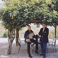 Michael Rosenberg and Leonard Kowalski with their Norwich terrier Hattie in the garden of their country retreat