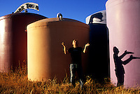 "Richard Heinichen, owner of Rainwater Bottled Water Company, looks to the skies to fill his massive tank farm--dubbed ""Tank Town."" In the Hill Country west of Austin, well-water is calcium laden, pants-stiffening and virtually undrinkable."