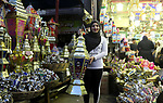 "A picture taken on May 8, 2018 show an Egyptian woman carries a traditional lantern known in Arabic as ""Fanous"", with photo of Egyptian player Mohammed Salah at a market ahead of the holy Muslim month of Ramadan in Cairo, Egypt. Ramadan is sacred to Muslims because it is during that month that tradition says the Koran was revealed to the Prophet Mohammed. The fast is one of the five main religious obligations under Islam. Muslims around the world will mark the month, during which believers abstain from eating, drinking, smoking and having sex from dawn until sunset. Photo by Amr Sayed"