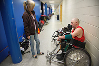 27 MAY 2013 - DONCASTER, GBR - Darren Bragg of the East Midlands Marauders prepares, with the assistance of his wife Gaynor Bragg, for his teams 5th / 6th place match during the 2013 Great Britain Wheelchair Rugby Nationals at The Dome in Doncaster, South Yorkshire (PHOTO (C) 2013 NIGEL FARROW)