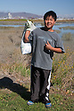 "Peter from Mills High School gives a thumbs up at the trash clean up. Volunteers in the City of Millbrae participated in California Coastal Cleanup Day on 9/19/09. Participants cleaned up inland locations throughout the city as well as at Bayfront Park on the San Francisco Bay shoreline. The inland cleanup efforts were important because, according to the California Coastal Commission, ""past Coastal Cleanup Day data tell us that most (between 60-80 percent) of the debris on our beaches and shorelines comes from inland sources, traveling through storm drains or creeks out to the beaches and ocean. Rain or even something as simple as hosing down a sidewalk can wash cigarette butts, bits of styrofoam, pesticides, and oil into the storm drains and out to the ocean."" The California Coastal Cleanup Day (http://www.coastal.ca.gov/publiced/ccd/ccd.html) is sponsored by the California Coastal Commission and is a part of the International Coastal Cleanup organized by The Ocean Conservancy."