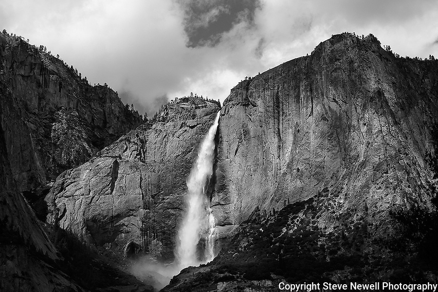 """Yosemite Falls Waterfall 6"" monochrome  Yosemite Falls Waterfall, Yosemite National Park, California. This is a monochrome photograph. I spent two weeks in the Spring of 2013 climbing up the opposite canyon's wall in order to get an angle that captured all three sections of the waterfall. I learned on the Yosemite National Park's website that no one had a photograph of the middle section of the waterfall.  Their description of the middle section is ""often ignored middle section""  All other photographers only have photographs showing an angle that has the upper and lower sections in view.  I had to climb down and return moving further up the canyon to get an angle to see directly into the middle section."