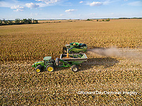 63801-08208 Corn Harvest, John Deere combine unloading corn into grain cart while harvesting - aerial Marion Co. IL