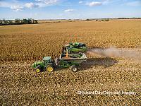 63801-08208 Corn Harvest, John Deere combine unloading corn into grain cart while harvesting - aerial Marion Co. IL