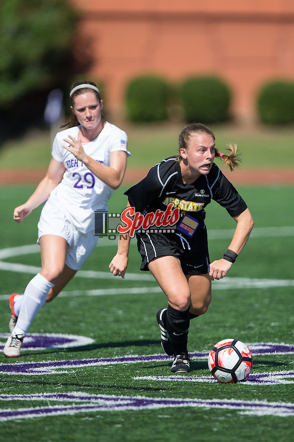 Carrie Taylor (17) of the Appalachian State Mountaineers keeps the ball away from Kelsey Perrell (29) of the High Point Panthers during first half action at Vert Track, Soccer & Lacrosse Stadium on August 26, 2016 in High Point, North Carolina.  The Panthers defeated the Mountaineers 2-0.  (Brian Westerholt/Sports On Film)