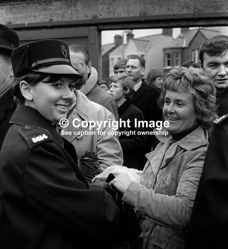 New Zealand All Blacks meet Ulster at Ravenhill, Belfast, N Ireland, 18th November 1972. The All Blacks won 16-9. The game was played at the height of The Troubles in N Ireland and security was very much in evidence. A policewoman checks a woman&rsquo;s handbag. 197211180739a<br />