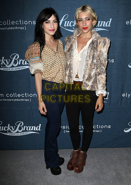 LISA MARIE ORIGLIASSO & JESSICA LOUSE ORIGLIASSO of The Veronicas .Lucky Brand celebrates a new movement in denim to benefit Art of Elysium Held at Eveleigh, West Hollywood, California, USA..September 21st, 2011.full length jeans denim black blue beige shirt fur jacket beige print sisters family band.CAP/ADM/KB.©Kevan Brooks/AdMedia/Capital Pictures.