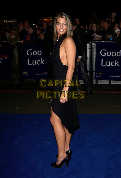 GEMMA ATKINSON.10th Anniversary National Television Awards. Royal Albert Hall, London, October 26th 2004..full length black dress .Ref: PL.www.capitalpictures.com.sales@capitalpictures.com.©Capital Pictures.