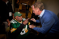 Former Green Bay Packer great Willie Davis points to NFL Commissioner Roger Goodell before the Packer alumni take the field for introductions prior to Green Bay's game against the Seattle Seahawks on Sept. 20, 2015.