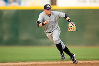 Shortstop Chris Valakia #11 of the Louisville Bats breaks on a ground ball at Knights Stadium June 23, 2009 in Fort Mill, South Carolina. (Photo by Brian Westerholt / Four Seam Images)