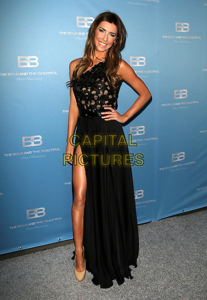 Jacqueline MacInnes Wood.25th silver anniversary party for CBS 'The Bold and the Beautiful' - silver carpet held at Hill Street., Los Angeles, California, USA..10th March 2012.full length dress black one shoulder slit split hand on hip.CAP/ADM/KB.©Kevan Brooks/AdMedia/Capital Pictures.