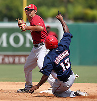 Houston Astros shortstop Jiovanni Mier turns a double play as Brian Goodwin #13 slides in during an Instructional League game against the Washington Nationals at Osceola County Stadium on September 26, 2011 in Kissimmee, Florida.  (Mike Janes/Four Seam Images)