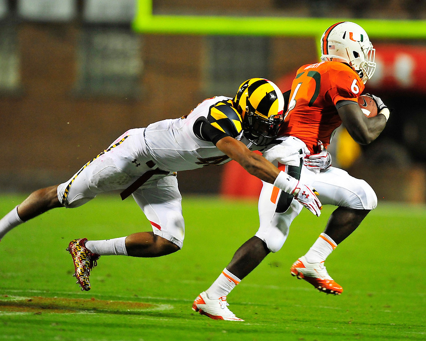 Hurricanes' Lamar Miller breaks a tackle for more yards. Maryland defeated Miami 32-24 during a game at the Byrd Stadium in College Park, MD on Monday, September 5, 2011. Alan P. Santos/DC Sports Box