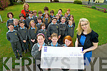 Third class pupils at Cullina National School, pictured with their teacher Marie Murphy, as they presented a cheque for ?401.38 to Elaine Murray, ISPCC, on Wednesday, after they held a Fairtrade Cake Sale at the school recently.