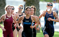 25 OCT 2003 - VOUGLIAMENI, ATHENS, GREECE - Delphine Pelletier (FRA) Beatrice Lanza (ITA) and Nadia Cortassa (ITA) race shoulder to shoulder at the Athens ITU World Cup triathlon round. (PHOTO (C) NIGEL FARROW)