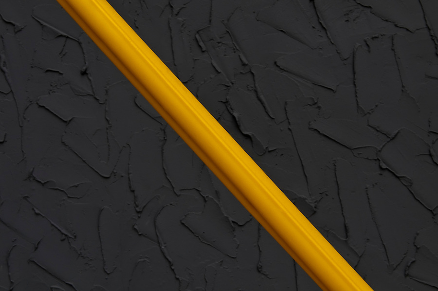 Fine Art Photography. A yellow line against a wall.