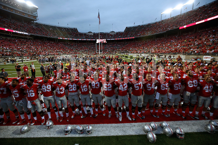 The Ohio State Buckeyes sing Carmen Ohio after the college football game between the Ohio State Buckeyes and the Western Michigan Broncos at Ohio Stadium in Columbus, Saturday afternoon, September 26, 2015. The Ohio State Buckeyes defeated the Western Michigan Broncos 38 - 12. (The Columbus Dispatch / Eamon Queeney)