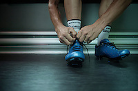 Christian Meier (CAN/Orica-GreenEDGE) getting his shoes on ahead of the race<br /> <br /> 2014 Tour de France<br /> stage 18: Pau - Hautacam (145km)
