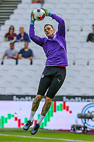 Goalkeeper Ederson of Manchester City warms up ahead of the Premier League match between West Ham United and Manchester City at the London Stadium, London, England on 10 August 2019. Photo by David Horn.