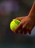 30-05-13, Tennis, France, Paris, Roland Garros, Ballkid holding tennisballs.
