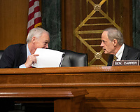 """United States Senator Ron Johnson (Republican of Wisconsin), left, and US Senator Tom Carper (Democrat of Delaware), right, share a private conversation prior to hearing testimony before the US Senate Committee on Homeland Security and Governmental Affairs Permanent Subcommittee on Investigations during a hearing on """"Examining Private Sector Data Breaches"""" on Capitol Hill in Washington, DC on Thursday, March 7, 2019.<br /> Credit: Ron Sachs / CNP/AdMedia"""