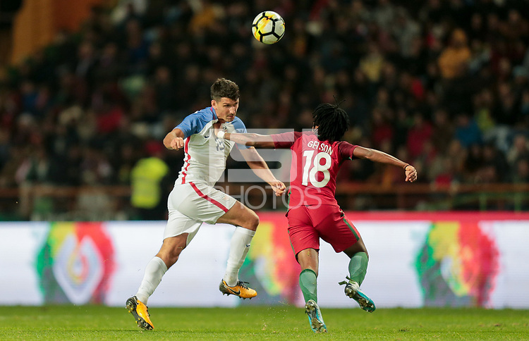 Leiria, Portugal - Tuesday November 14, 2017: Eric Lichaj, Gelson Martins during an International friendly match between the United States (USA) and Portugal (POR) at Estádio Dr. Magalhães Pessoa.