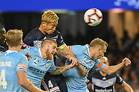 Melbourne, October 20, 2018 - Keisuke Honda of Melbourne Victory heads a goal in the round one match of the A-League between Melbourne Victory and Melbourne City at Marvel Stadium, Melbourne, Australia. Photo Sydney Low