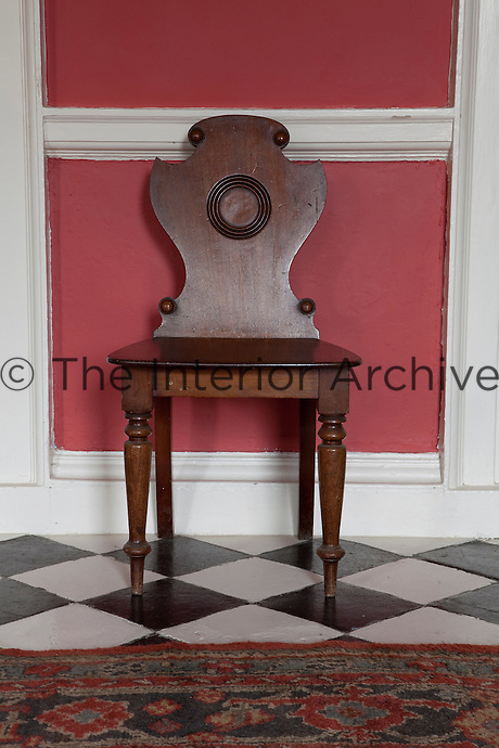 One of a set of Irish Georgian hall chairs to furnish the entrance hall