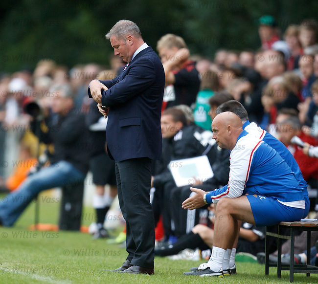 Ally McCoist checking the time on his watch