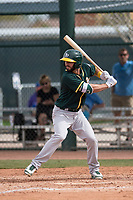 Oakland Athletics infielder Trent Gilbert (30) at bat during a Minor League Spring Training game against the Chicago Cubs at Sloan Park on March 13, 2018 in Mesa, Arizona. (Zachary Lucy/Four Seam Images)