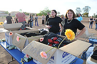 "Gilbert, Arizona – Friends and family of the Mederos Family gathered to hold a memorial for the four victims of the Gilbert Massacre occurred on May 2, 2012. According to Gilbert Police, Lisa Mederos, Amber Mederos, baby Lilly Mederos, and Jim Hiott (Amber's fiancé) were all killed by notorious white supremacist and Neo-Nazi Jason ""J.T."" Ready before taking his own life. In this image, two women volunteers are in charge of selling t-shirts in memory of Lisa Mederos, Amber Mederos, Lilly Mederos and Jim Hiott as a fundraiser for the survivors. Photo by Eduardo Barraza © 2012"