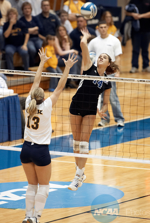 03 DEC 2005:  Meghan Moore (14) of Grand Valley State attempts a kill over Ashley Solt (13) of Nebraska-Kearney at the Division II Women's Volleyball Championship held at the Health and Sports Center in Kearney, NE. Grand Valley State University defeated the University of Nebraska- Kearney 3-1 to win the national title. Scott Anderson/NCAA Photos