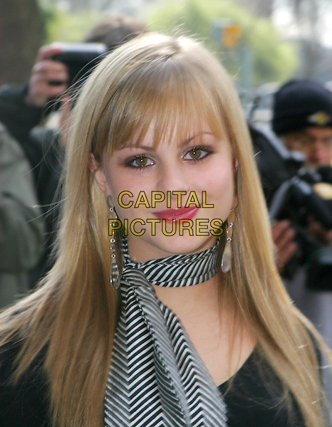 TINA O'BRIEN.TRIC Awards at Le Meridien Grosvenor House.09 March 2004.headshot, portrait, striped scarf, neckerchief.www.capitalpictures.com.sales@capitalpictures.com.© Capital Pictures.