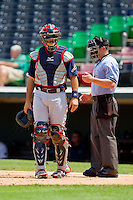 Gwinnett Braves catcher Matt Pagnozzi (19) looks to his dugout as home plate umpire Toby Basner looks on during the International League game against the Charlotte Knights at Knights Stadium on July 28, 2013 in Fort Mill, South Carolina.  The Knights defeated the Braves 6-1.  (Brian Westerholt/Four Seam Images)