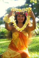 Island woman giving a yellow plumeria lei as a gretting for an arriving visitor