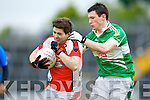 James O'Sullivan Rathmoretries to get past Legion's Kevin Breen during their Club championship semi final in Fitzgerald Stadium on Saturday
