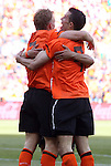 """14 JUN 2010:  Dirk Kuyt (NED)(7), Robin van Persie (NED)(9), and unidentified third Dutch player celebrate the game winning """"own goal"""".  The Netherlands National Team defeated the Denmark National Team 2-0 at Soccer City Stadium in Johannesburg, South Africa in a 2010 FIFA World Cup Group E match."""