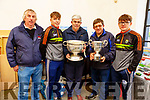 Denis Murphy, Killian Falvey, Joe McCarthy, Brendan O'Brien and Colm Moriarty with the Tommy Markin Cup and the Munster Minor Cup at the Threshing Festival in Blennerville on Sunday.