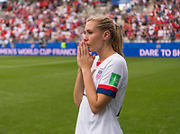 REIMS,  - JUNE 24: Allie Long #22 watches her team take the field during a game between NT v Spain and  at Stade Auguste Delaune on June 24, 2019 in Reims, France.