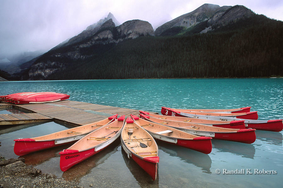Canoes await paddlers on Lake Louise, Banff National Park, Alberta, Canada