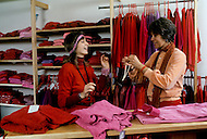 Wasco, Oregon, January 1984: A clothing store in Rajneeshpuram with garments in shades of red. The disciples of Bhagwan Rajneesh always wore various shades of red, which according to this religion was the color of life, the sun, of birth and regeneration. Rajneeshpuram, was an intentional community in Wasco County, Oregon, briefly incorporated as a city in the 1980s, which was populated with followers of the spiritual teacher Osho, then known as Bhagwan Shree Rajneesh. The community was developed by turning a ranch from an empty rural property into a city complete with typical urban infrastructure, with population of about 7000 followers.
