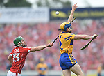 Alan Cadogan of Cork in action against Seadna Morey of Clare during their Munster senior hurling final at Thurles. Photograph by John Kelly.