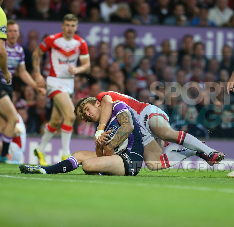 St Helens Paul Clough is tackled by Wigan Warriors James Roby- First Utility Super League Grand Final - St Helens v Wigan Warriors - Old Trafford Stadium - Manchester - England - 11th October 2014 - Pic Paul Currie/Sportimage